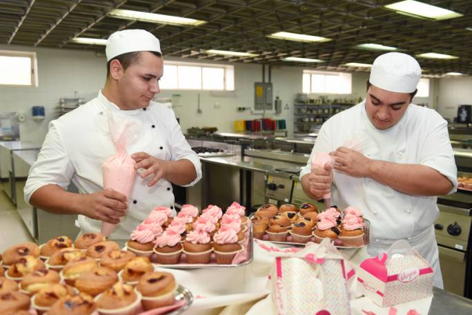 ITS students prepare Pink October cupcakes with proceeds going towards the Marigold Foundation for Breast Cancer Awareness Month